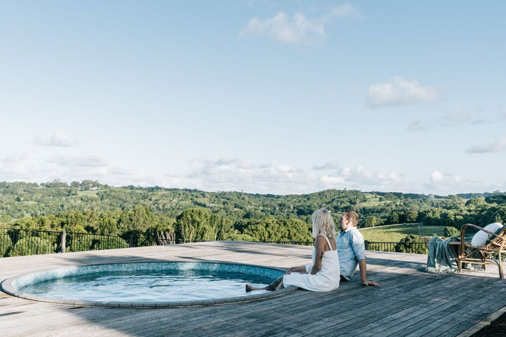 romantic getaway couple honeymoon babymoon relaxing by pool beautiful rural landscape views Federal Heartwood Farm Byron Bay luxury farm stay accommodation