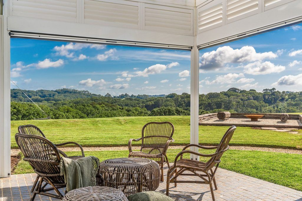 cottage-fire-pit-beautiful-rural-landscape-views-cane-chairs-Federal-Heartwood-Farm-Byron-Bay-luxury-farm-stay-accommodation