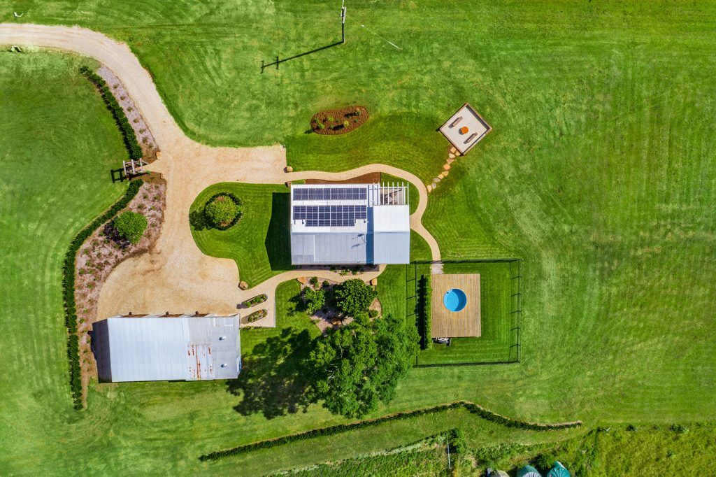 cottage-pool-fire-pit-beautiful-rural-landscape-views-aerial-Federal-Heartwood-Farm-Byron-Bay-luxury-farm-stay-accommodation